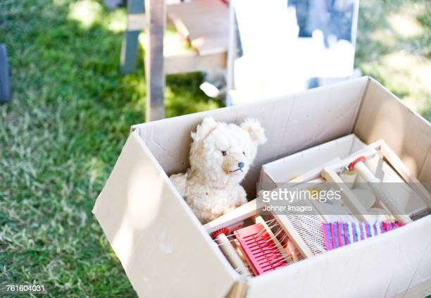 toys in cardboard box - flea market stock pictures, royalty-free photos & images