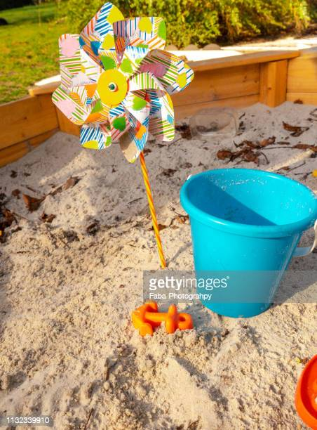toys in sandpit - spaß stock pictures, royalty-free photos & images