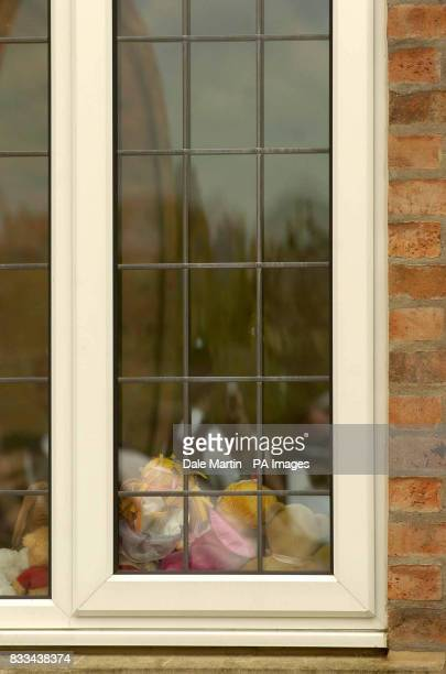 Toys in the window of the McCann house as the family of missing toddler Madeleine arrive home to Rothley Leicestershire today