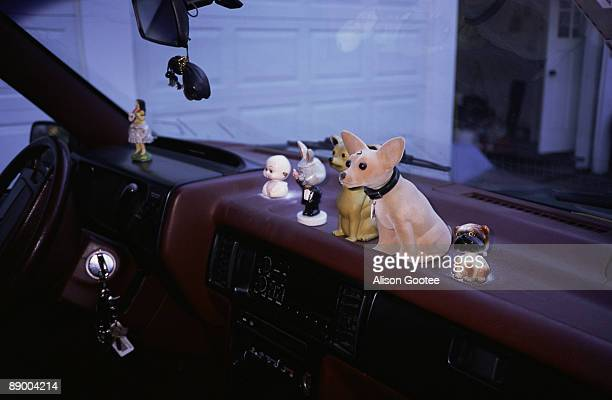 Toys on car dashboard
