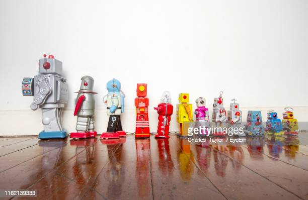 toys on hardwood floor against wall - eyeem collection stock pictures, royalty-free photos & images