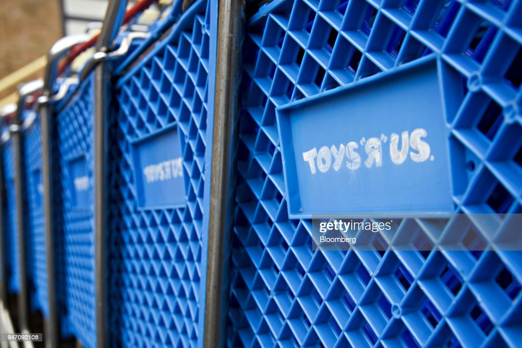 Toys R Us Inc. signage is displayed on a shopping cart outside the retail store in Frederick, Maryland, U.S., on Monday, April 16, 2018. Billionaire Isaac Larian, the toy marketer whose lineup includes Little Tikes and Bratz dolls, offered to save part of Toys 'R' Us from liquidation with an almost $900 million bid for stores in the U.S. and Canada. Photographer: Andrew Harrer/Bloomberg via Getty Images
