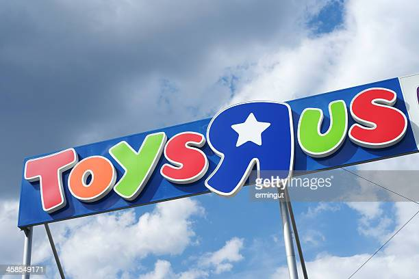 Toys R Us logo against clouded sky