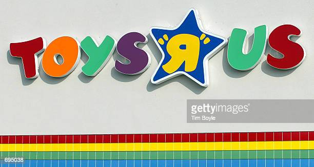 Toys R Us sign is visible at a Toys R Us store January 28 2002 in Arlington Heights IL Toys R Us Inc plans to cut 1900 jobs and to close 27 Toys R Us...