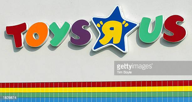 A Toys R Us sign is visible at one of its stores January 28 2002 in Arlington Heights Illinois The company reported a 76 percent jump in its fourth...