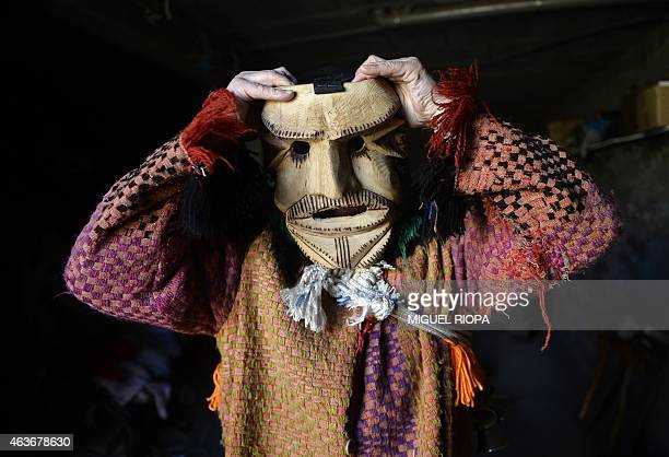 Toze a reveller from the Portuguese village of Vila Boa de Ousilhao in northeastern Portugal wears a wooden mask during the traditional Celtic...