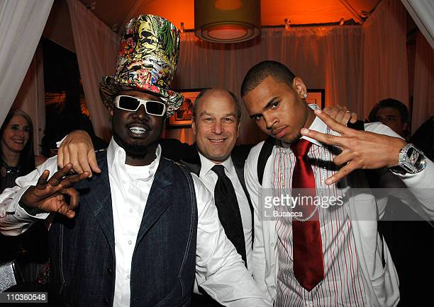 TPain Barry Weiss President and CEO Zomba Label Group and Chris Brown pose during the Sony/BMG Grammy After Party at the Beverly Hills Hotel on...
