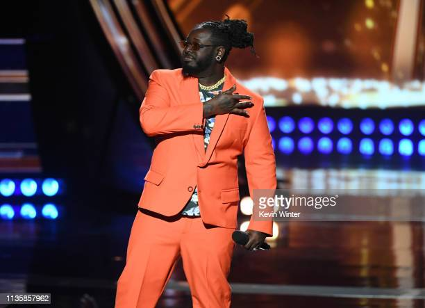 TPain speaks on stage at the 2019 iHeartRadio Music Awards which broadcast live on FOX at the Microsoft Theater on March 14 2019 in Los Angeles...