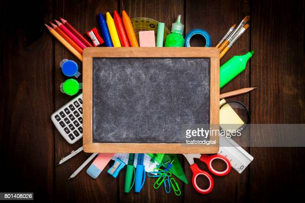 Tpo view of school or office supplies on dark wooden table