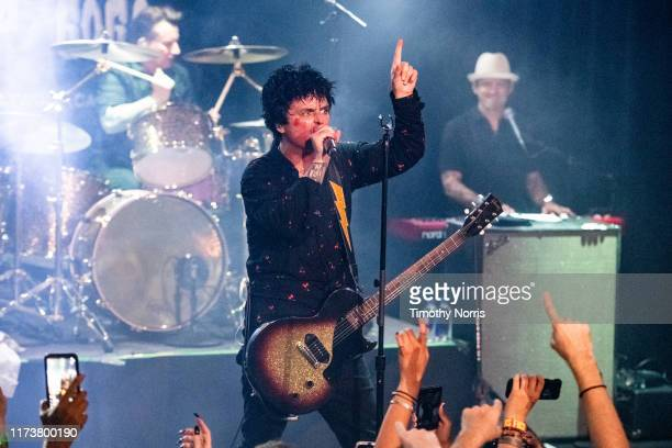 """Tré Cool Billie Joe Armstrong and Jason Freese of Green Day perform during the """"Hella Mega Tour"""" announcement show at Whisky a Go Go on September 10..."""