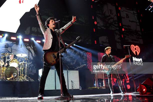 Tré Cool Billie Joe Armstrong and Mike Dirnt of Green Day perform onstage during the 2019 iHeartRadio Music Festival at TMobile Arena on September 20...