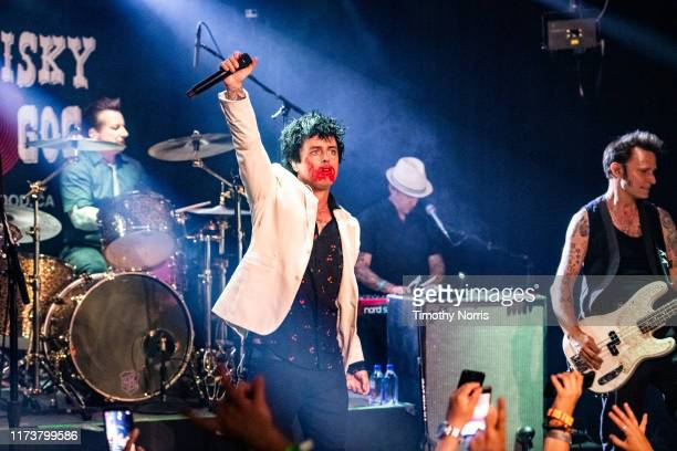 "Tré Cool Billie Joe Armstrong and Mike Dirnt of Green Day perform during the ""Hella Mega Tour"" announcement show at Whisky a Go Go on September 10..."
