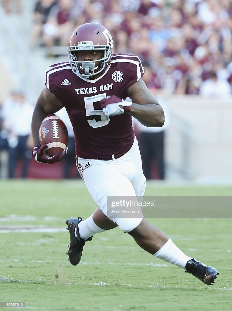 Tra Carson #5 of the Texas A&M Aggies runs with the ball in the first half of their game against the Ball State Cardinals at Kyle Field on September 12, 2015 in College Station, Texas.