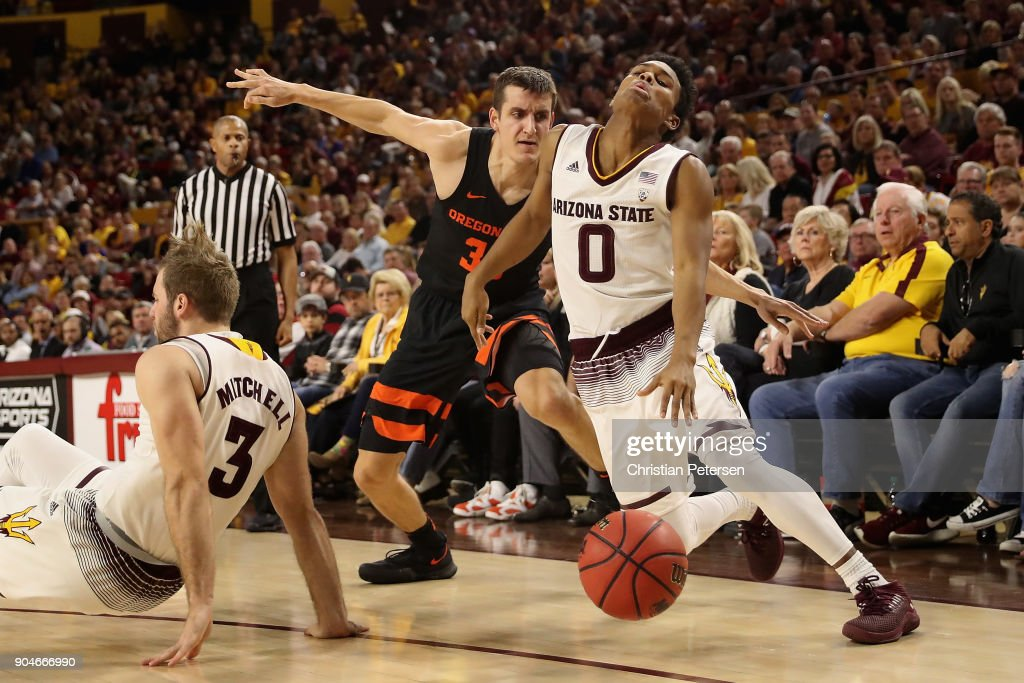 Tra Holder #0 of the Arizona State Sun Devils handles the ball under pressure from Seth Berger #32 of the Oregon State Beavers during the second half of the college basketball game at Wells Fargo Arena on January 13, 2018 in Tempe, Arizona. The Sun Devils defeated the Beavers 77-75.
