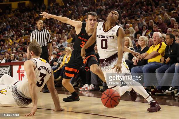 Tra Holder of the Arizona State Sun Devils handles the ball under pressure from Seth Berger of the Oregon State Beavers during the second half of the...