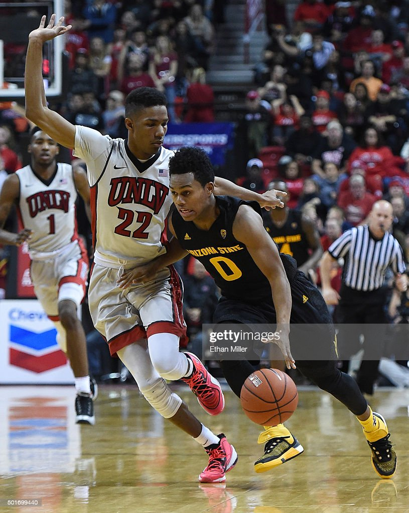 Tra Holder #0 of the Arizona State Sun Devils is guarded by Patrick McCaw #22 of the UNLV Rebels during their game at the Thomas & Mack Center on December 16, 2015 in Las Vegas, Nevada. Arizona State won 66-56.