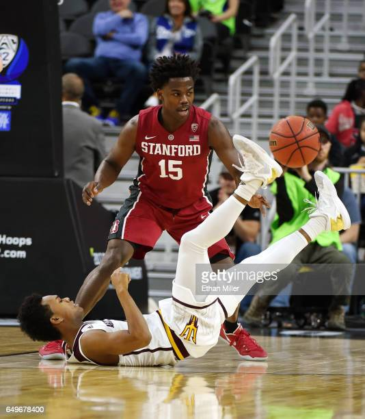Tra Holder of the Arizona State Sun Devils passes from the floor in front of Marcus Allen of the Stanford Cardinal during a firstround game of the...