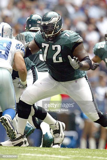 Tra Thomas of the Philadelphia Eagles makes a block during a game against the Dallas Cowboys on October 12 2003 at Texas Stadium in Irving Texas
