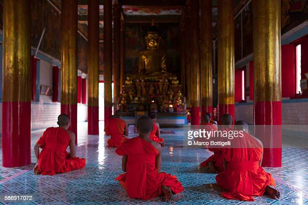 tra vinh, mekong delta, southern vietnam. khmer krom monks praying in the temple. - khmer stock pictures, royalty-free photos & images