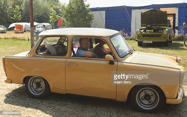 Trabant automobile passes at a Trabant enthusiasts' weekend on August 8 2015 near Nossen Germany The Trabant also called the Trabi is the iconic car...
