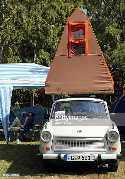 Trabant automobile with a camping tent atop it sits parked at a Trabant enthusiasts' weekend on August 8 2015 near Nossen Germany The Trabant also...