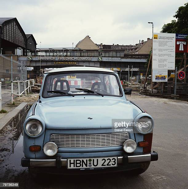 A Trabant car parked outside Friedrichstrasse Station in post unification Berlin August 1993