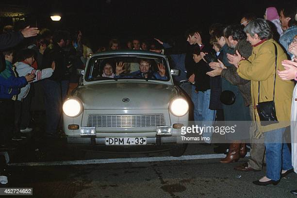 Trabant is welcomed by people at the former inner German border after opening of the border on November 09 in Berlin Germany The year 2014 marks the...