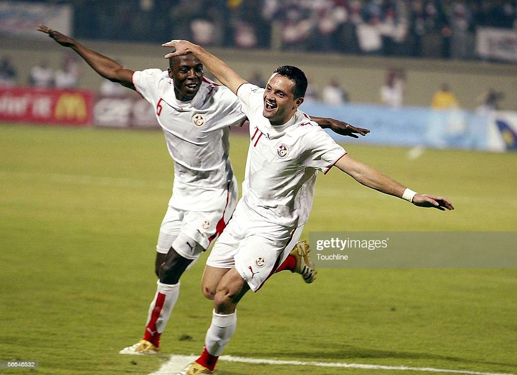 Trabelsi Hatem and Silva Dos Santos of Tunisia celebrate a goal during the African Cup of Nations match between Tunisia and Zambia at the Border Guard Stadium on January 22, 2006 in Alexandria, Egypt.