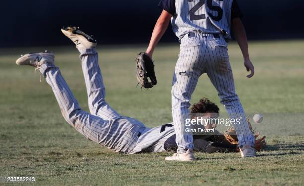 Trabuco Hills centerfielder Drew Barrett dives but cant make the catch on a Thousand Oaks hit allowing the tying run to score in the fifth inning of...