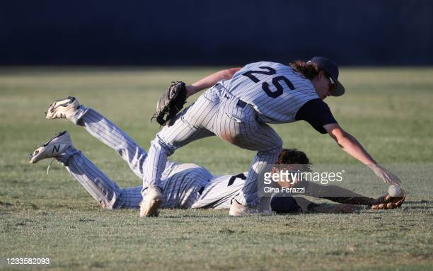 Trabuco Hills shortstop Nicolas Tanaka grabs the ball after centerfielder Drew Barrett dives but cant make the catch on a Thousand Oaks hit allowing...