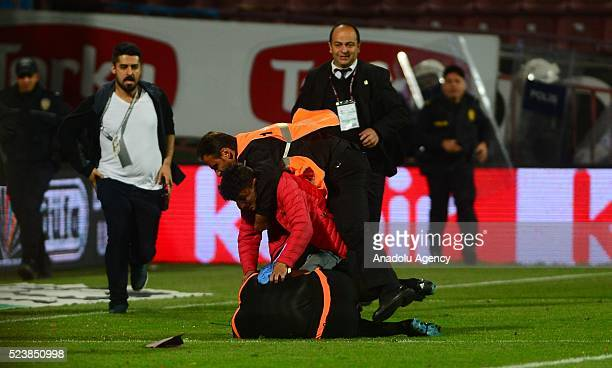 Trabzonspor fan attacks to referee during the Turkish Spor Toto Super Lig football match between Trabzonspor and Fenerbahce at Avni Aker Stadium in...