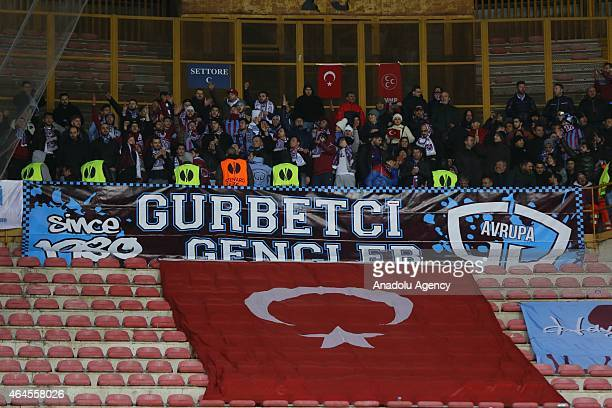 Trabzonspor fans support their team during the UEFA Europa League Round of 32 second leg football match between Napoli and Trabzonspor AS at the San...