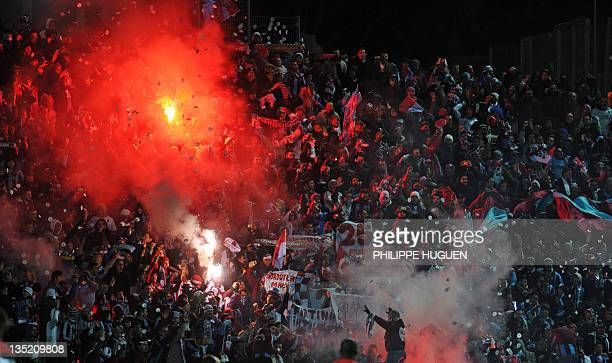 Trabzonspor supporters cheer their team during the UEFA Champions League Group B football match Lille vs Trabzonspor AS on December 7 2011 at the...