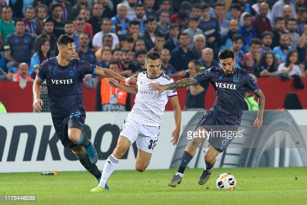Trabzonspor's Argentinian midfielder Jose Ernesto Sosa and Basel's Swiss midfielder Kevin Bua fight for the ball during the UEFA Europa League group...