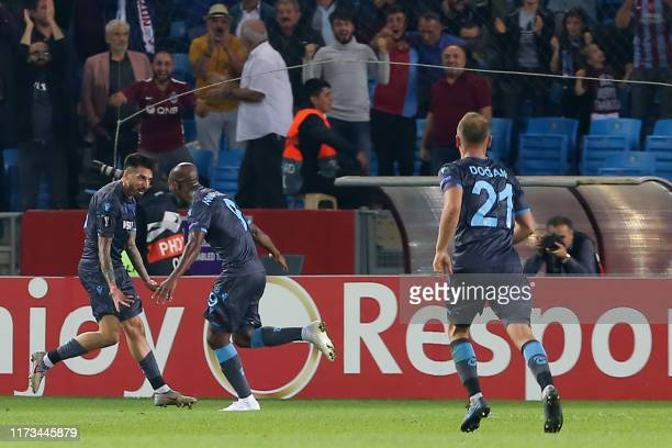 Trabzonspor's Argentinian midfielder Jose Ernesto Sosa celebrates with teammates after scoring a goal during the UEFA Europa League group C football...