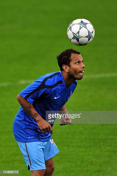 Trabzonspor's Brasilian midfielder Alazinho eyes the ball during a training session on September 13 2011 at San Siro Stadium the day before their...