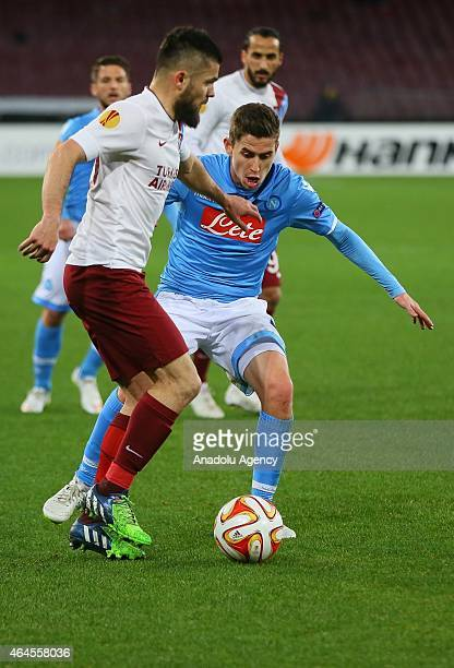 Trabzonspor's Carl Medjani vies with Napoli's Jorginho during the UEFA Europa League Round of 32 second leg football match between Napoli and...