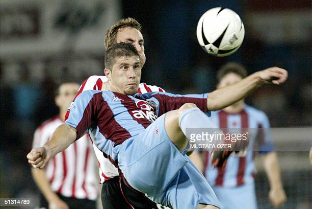 Trabzonspor's Mehmet Yilmaz fights for the control of the ball with Athletic Bilbao's Murillo during their UEFA Cup first round first leg match at...