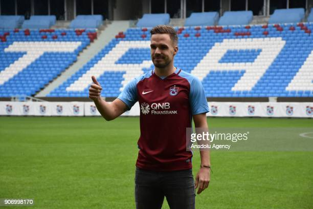 Trabzonspor's new signing Filip Novak poses for a photo after his signing ceremony at Medical Park Stadium in Trabzon Turkey on January 19 2018