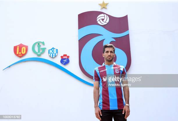 Trabzonspor's new transfer Iranian national player Vahid Amiri poses for a photo with the jersey in Trabzon Turkey on July 21 2018