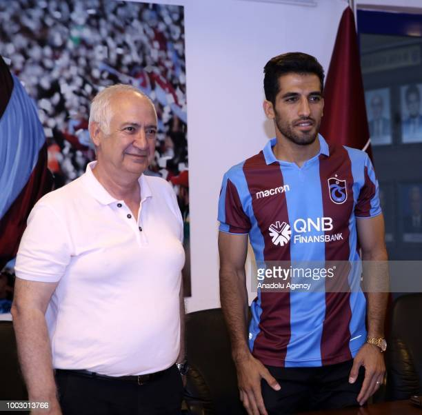 Trabzonspor's new transfer Iranian national player Vahid Amiri poses for a photo with President of Trabzonspor Hayrettin Hacisalihoglu during the...