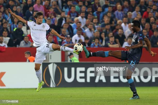 Trabzonspor's Nigerian midfielder John Obi Mikel and Basel's Swiss midfielder Valentin Stocker fight for the ball during the UEFA Europa League group...