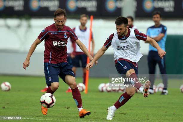 Trabzonspor's Pereira and Huseyin Turkmen in action during a training session held ahead of Turkish Super Lig week 5 match against Aytemiz Alanyaspor...