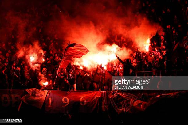 Trabzonspor's supporters hold red flares and flags during the UEFA Europa League Group D football match between FC Basel 1893 and Trabzonspor AS at...