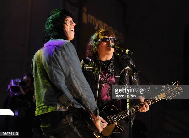 Trace Cyrus and Mason Musso of Metro Station perform at the Alice In Wonderland Great Big Ultimate Fan Event at Hollywood Highland Courtyard on...