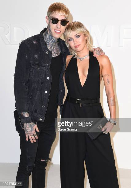 Trace Cyrus and Miley Cyrus arrives at the Tom Ford AW20 Show at Milk Studios on February 07 2020 in Hollywood California