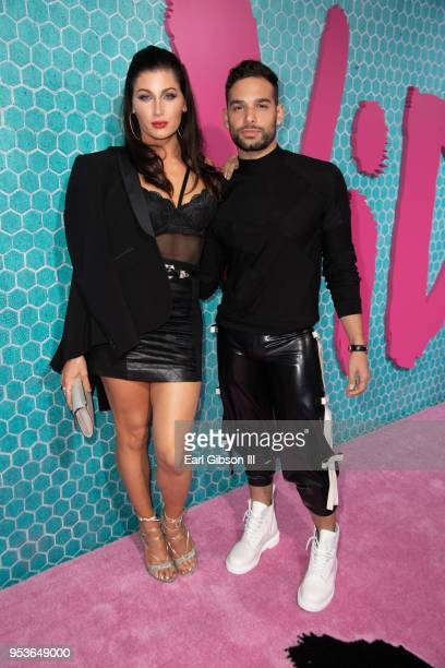 Trace Lysette and Johnny Sibilly attend Starz 'Vida' Premiere at Regal LA Live Stadium 14 on May 1 2018 in Los Angeles California