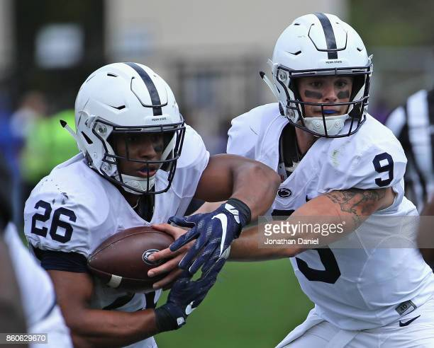 Trace McSorley of the Penn State Nittany Lions hands off to Saquon Barkley of the Penn State Nittany Lions against the Northwestern Wildcats at Ryan...