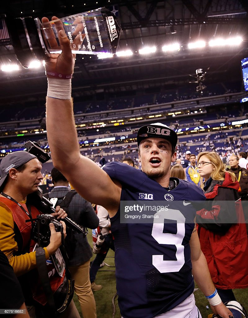 Trace McSorley #9 of the Penn State Nittany Lions holds up the Most Valuable Player trophy as he walks off the field after the Big Ten Championship game against the Wisconsin Badgers at Lucas Oil Stadium on December 3, 2016 in Indianapolis, Indiana.