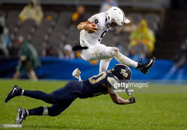 Trace McSorley of the Penn State Nittany Lions hurdles Dennis Briggs of the Pittsburgh Panthers in the fourth quarter on September 8 2018 at Heinz...